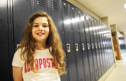 "Shyanne Williams, a sixth-grader at Lansdowne Middle School, poses in the hallway. She is one of five Baltimore County public school students named as finalists in the 28th annual ""Champions of Courage"" Black History Month Essay competition."