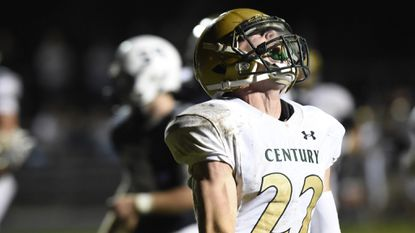 Century's Charlie Hackett yells after scoring a touchdown against Manchester Valley.