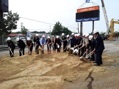 Officials with the mall's owners and developer Greenberg Gibbons join elected officials from Laurel and Prince George's County in turning over a shovel of dirt to mark the beginning of Laurel Mall's transformation into Towne Centre at Laurel.