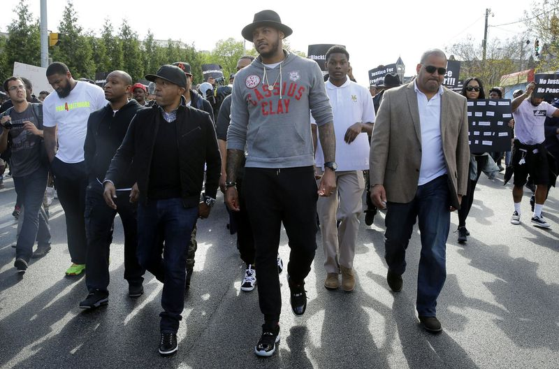 Carmelo Anthony, center, marches to Baltimore City Hall to protest the death of Freddie Gray on April 30, 2015, in Baltimore.