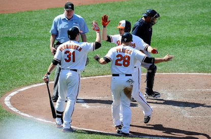 Danny Valencia celebrates with Taylor Teagarden and Steve Pearce after hitting a home run in the sixth inning against Seattle.