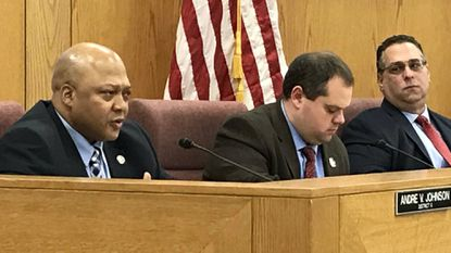 """Harford County Councilman Andre Johnson, left, laments Tuesday what he called the """"senseless"""" death of food delivery driver Timothy Wayne Youngquist, who was fatally shot Sunday night in Edgewood."""
