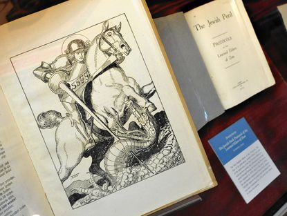 "Two pernicious examples of forgeries on display are the ""Protocols of the Learned Elders of Zion,"" including the first German edition with illustration, 1919, left, and an English edition from 1920. A new exhibit, ""Fakes, Lies and Forgeries,"" at the George Peabody Library will be on view through Feb. 1, 2015."