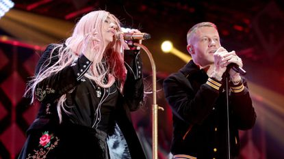 Kesha (left) and Macklemore — photographed here performing in Inglewood, Calif., on Dec. 1 — will perform at Jiffy Lube Live next year.