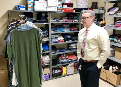 Bernard Hennigan, executive director of student support services for Harford County Public Schools, looks around Magnolia Middle School's Care Closet following a ribbon-cutting ceremony last Friday. The closet is used to store supplies for Magnolia students in need, as well as their families.