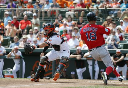 Baltimore Orioles' Caleb Joseph reaches out for the throw as Boston Red Sox' David Murphy runs past scoring on a Sandy Leon sacrifice fly in the third inning of a spring training baseball game, Saturday, March 26, 2016, in Sarasota, Fla.