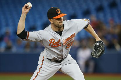 Darren O'Day #56 of the Baltimore Orioles delivers a pitch in the eighth inning during MLB game action against the Toronto Blue Jays on April 22, 2015 at Rogers Centre in Toronto, Ontario, Canada.