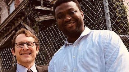 Former Baltimore Housing Commissioner Michael Braverman, left, with developer Ernst Valery outside the long-vacant Sellers Mansion in West Baltimore in May 2019.