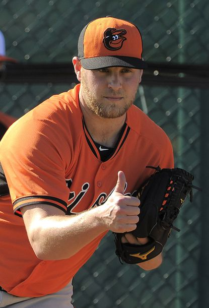 Meek, a reliever on the comeback trail, hopes it leads to Baltimore