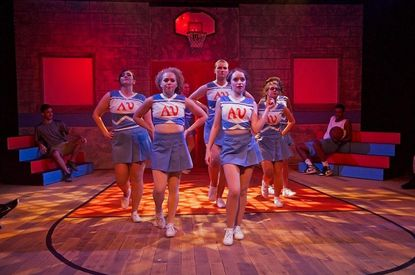 The cheerleaders, led by Hailey Ibberson, center, take to the floor at Red Branch Theatre.