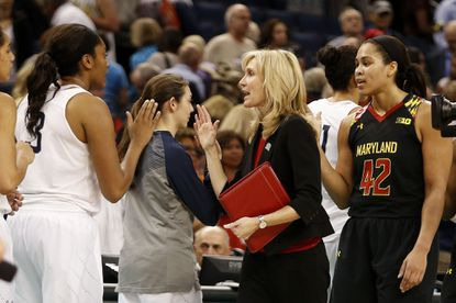 TAMPA, FL - APRIL 05: Assistant coach Tina Langley of the Maryland Terrapins congratulates Morgan Tuck #3 of the Connecticut Huskies after the Huskies defeated the Terrapins 81 to 58 during the NCAA Women's Final Four Semifinal at Amalie Arena on April 5, 2015 in Tampa, Florida. (Photo by Brian Blanco/Getty Images) ORG XMIT: 527066965