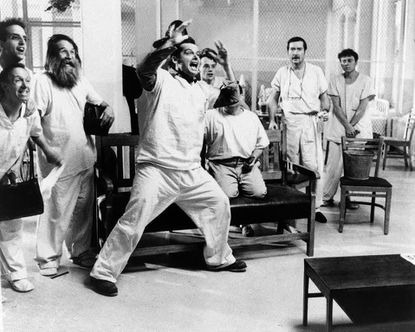 """**FILE** In a in Nov. 1975 file photo, actor Jack Nicholson is shown in a scene from the movie """"One Flew Over The Cuckoo's Nest"""". Oregon State Hospital, the mental institution where the 1975 movie """"One Flew Over the Cuckoo's Nest"""" was filmed, is making way for a new complex. Most of the dilapidated, 125-year-old main building will be torn down and replaced starting this fall. (AP Photo/United Artist, File) ORG XMIT: PD103"""