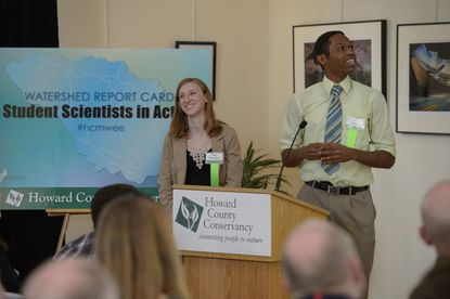 Mt. Hebron High School sophomores Sara Chernikoff and Nathan Johnson present their research during the Watershed Summit held Wednesday at the Howard County Conservancy in Woodstock.