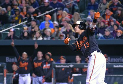 Baltimore, MD -- 04/08/2016 -- The Orioles bench reacts as Manny Machado (13) watches the flight of his solo home run off Tampa Bay Rays starting pitcher Chris Archer during the fifth inningat Camden Yards on April 8, 2016.