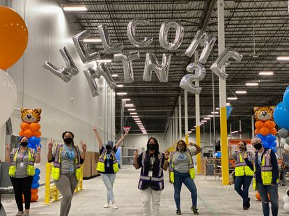 Amazon's local leadership team welcomed new associates into the Aberdeen sorting center.