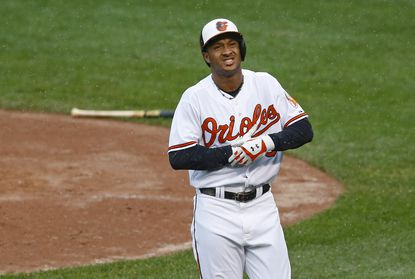 Orioles' Jonathan Schoop reacts after being hit by a pitch in the first inning against the Toronto Blue Jays, Thursday, Oct. 1, 2015, in Baltimore.