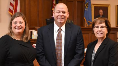 Harford County State's Attorney Al Peisinger, center, is joined by his deputy state's attorneys, MiaBeth Marosy, left, and M. Teresa Garland after they were sworn in Jan. 7 in the ceremonial courtroom of the Harford County Courthouse in Bel Air.