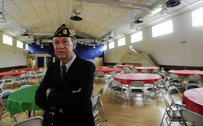 Jim Rebbert, commander of American Legion Towson Post 22, stands in the ballroom at the Legion Post. The post and the Greater Towson Council of Community Associations have spoken out against a rezoning request that would impact the American Legion property, part of the Towson Triangle formed by West Towsontown Boulevard, Bosley Avenue and York Road.