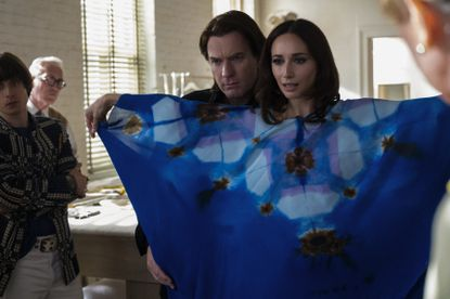 """Elsa Peretti (Rebecca Dayan) tries on a newly created caftan from Halston (Ewan Gregor), in """"Halston."""" The garment that would become a Halston signature piece. (Jojo Whilden/Netflix)"""