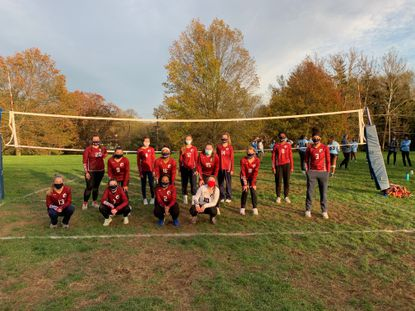 The Gerstell Academy girls volleyball team poses after playing its first-ever match Tuesday at Garrison Forest.