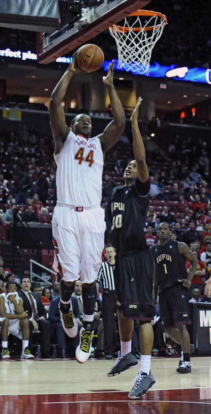 Maryland's Shaquille Cleare, left, goes up for a dunk over IUPUI's Donovan Gibbs in the second half.