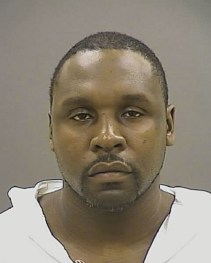 Dennis Padgett, 34, is charged with killing two neighbors in Baltimore on Jan. 9 after an ongoing dispute over parking.