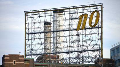 As workers remove more letters from the Domino Sugars sign, all that remains on Friday, March 12, 2021 is the word 'no.'