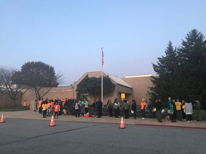 Community members gather outside the Howard County Board of Education headquarters in Ellicott City before the fourth redistricting work session Tuesday, Nov. 5, 2019.