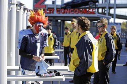 Tennessee Titans fan goes through a security check point outside Nissan Stadium before an NFL game between the Titans and the Miami Dolphins on Sunday, Oct. 18, 2015, in Nashville, Tenn.
