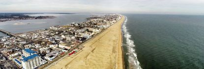 """Ocean City's vulnerability to climate change is best seen from above as the densely populated barrier island is already prone to """"blue sky"""" floods where high tides push inland even on sunny days, a product of climate change-driven sea level rise. (Larry Rogers/Capital Gazette)."""