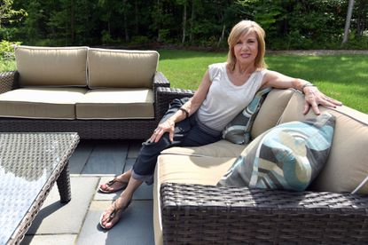 Sarah Fleischer, long-time DJ for Baltimore radio station 98 Rock, retired this year after 38 years. Fleischer relaxes in the backyard of her Millersville home.