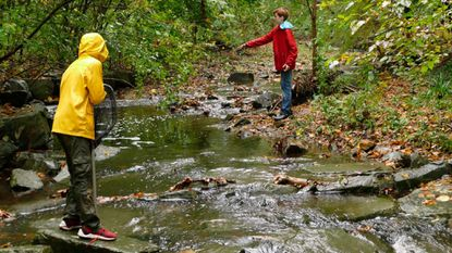 From left, brothers Jake, 10, and Roman Dombrowski,13, of Cedarcroft, fish at Stony Run in Roland Park on Oct. 29.