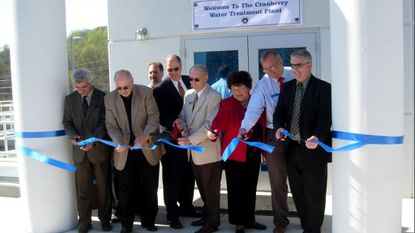 On April 24, 2008 officials cut the ribbon for the new Westminster Cranberry Water Treatment Plant. From right: Ben Movahed, Council President Roy Chiavacci, Dr. Robert M. Summers, Mayor Tom Ferguson, County Commissioner Julia Gouge, council members Dr. Robert Wack and Kevin Utz.