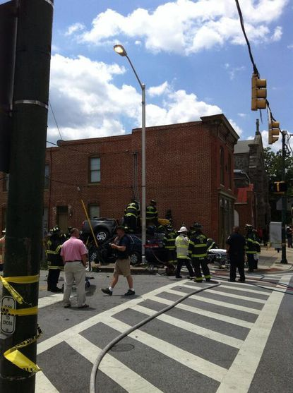 An accident scene is shown at Washington Boulevard and South Carey Street.