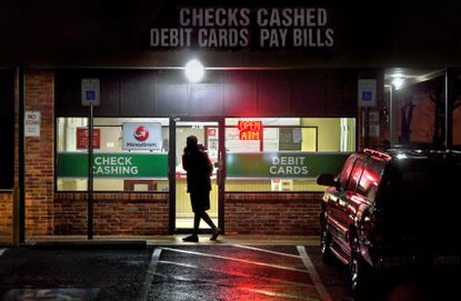 A customer leaves a payday loan store in Gaithersburg, Maryland, in February 2019. Washington Post photo by Michael S. Williamson