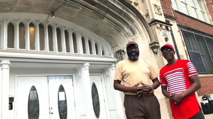 Archie Lee and Marlo Hargrove, founders of FACE, at the entrance of the old Frederick Douglass High School in West Baltimore.