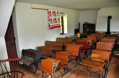 """A collection of desks in the Free School ranges in age, manufactured between 1868-1940s. The Free School is a living history classroom, a museum and repository for educational artifacts that has been """"resurrected"""" and is maintained by the Anne Arundel Retired School Personnel Association (AARSPA) in conjunction with the Anne Arundel County Board of Education."""