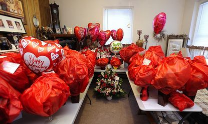 Evelyn Beall uses space in her Westminster apartment to store overflow Valentine's Day flower orders from her shop ahead of the holiday Tuesday.
