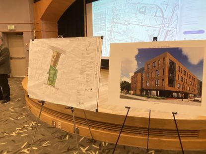 A rendering and design plan of Red Maple Place are displayed at a community input meeting Oct. 29 in Towson.