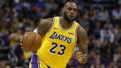Lakers forward LeBron James controls the ball in the second half against the Phoenix Suns on March 2 in Phoenix.