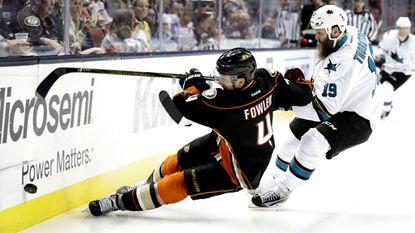 Ducks defenseman Cam Fowler beats Sharks center Joe Thornton to the puck during a game last season.