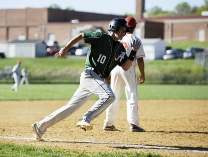 The Atholton baseball team (12-3) took control of first place in Howard County with only two games left after beating Howard, 10-2, on May 3 and an Oakland Mills loss (11-4). Senior shortstop Joe Bentz is shown here scoring a run in an 8 inning 5-4 loss at Glenelg May 2.