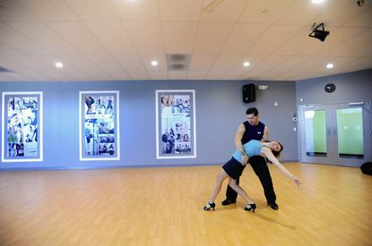 Renee Wooding of Timonium rehearses a dance with her dance partner, Juan Alzamora, on April 7, at Lydia Haskell's Fitness Rave in White Marsh. They will perform at the Alzheimer's Association of Central Maryland's Memory Ball fundraiser.