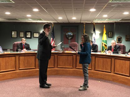 Deborah Painter, right, is sworn in to the Hampstead Town Council by Mayor Christopher Nevin Tuesday, March 10.