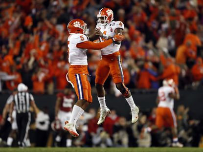 Clemson's Deshaun Watson and Shaq Smith celebrate a last-second touchdown during the second half of the NCAA college football playoff championship game against Alabama Tuesday, Jan. 10, 2017, in Tampa, Fla.