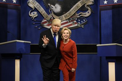 "In this photo provided by NBC, Alec Baldwin, left, as Donald Trump, and Kate McKinnon, as Hillary Clinton, perform during the ""Debate Cold Open"" sketch on the 42nd season of ""Saturday Night Live"" in New York on Oct. 1, 2016."