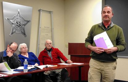 Members of the Joppa/Joppatowne Community Council listen as Robert Oberle of BGE talks about smart meters at the council's April 10 meeting. Oberle answered a number of questions about the controversial meters.