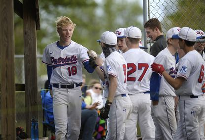 Carroll Christian's Cam Wooden celebrates with teammates after he scored in the first inning of the Patriots' win over Harford Christian in Westminster Friday April 30, 2021.