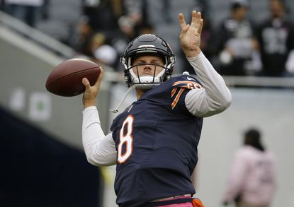 Chicago Bears quarterback Jimmy Clausen (8) warms up before an NFL football game against the Oakland Raiders, Sunday, Oct. 4, 2015, in Chicago. (AP Photo/Nam Y. Huh) ORG XMIT: CXB110