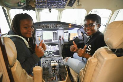Rising seniors Shani and Kelli are all smiles as they sit in the pilot and co-pilot seats of an airplane during a visit to Teterboro Airport, on Tuesday, July 23, in New Jersey. The two high school students are part of a seven week coding program focused on computer science and hosted by United Technologies Corp. The company is collaborating with Girls Who Code on a strategy to increase the amount of women in STEM fields.